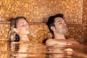 Spa Day – Comano Terme piscine + massaggio € 74